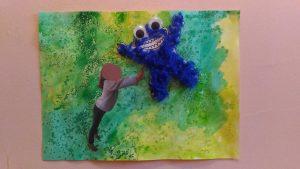 activité manuelle avec une photo d'un enfant qui repousse un monstre