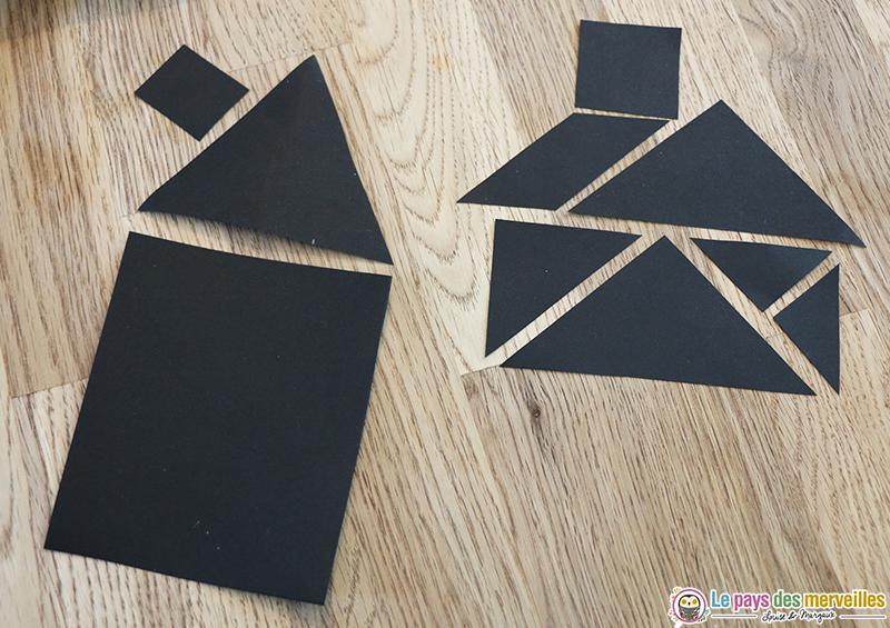 Tangram maison dans du papier noir