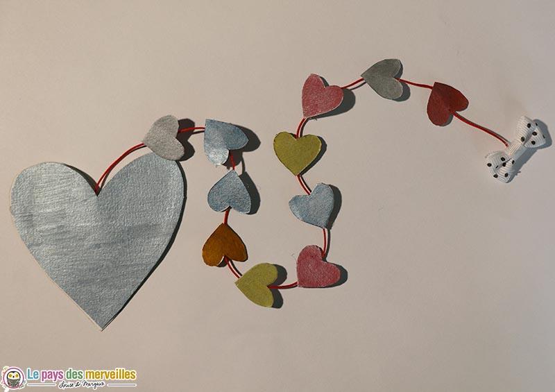 carte coeur avec guirlande de coeurs à tirer