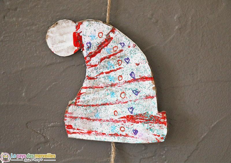 Bonnet de Noël peint avec l'empreinte d'une ficèle