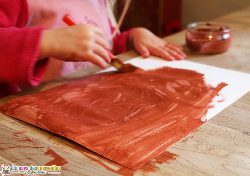 Peinture marron sur une feuille blanche Canson