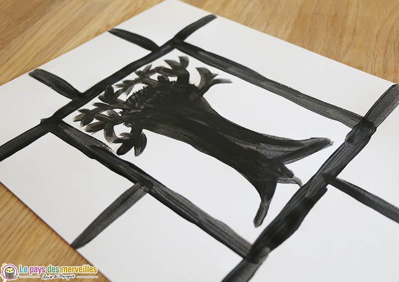 Peindre un arbre noir au centre d'une feuille