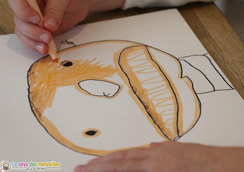 Coloriage d'un portrait réalisé par un enfant de maternelle
