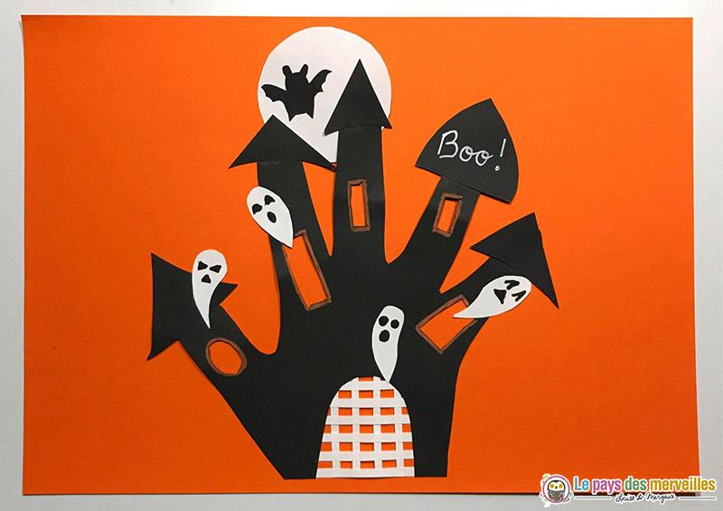 Bricolage d'Halloween château hanté avec une empreinte de main