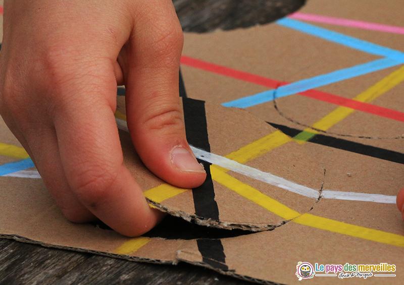 puzzle en carton main enfant