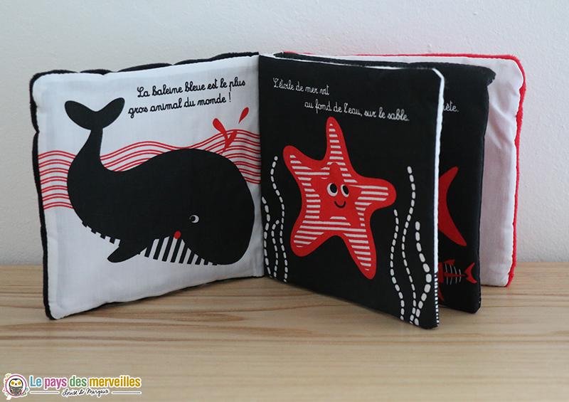 Livre en tissu avec des images en noir, blanc et rouge