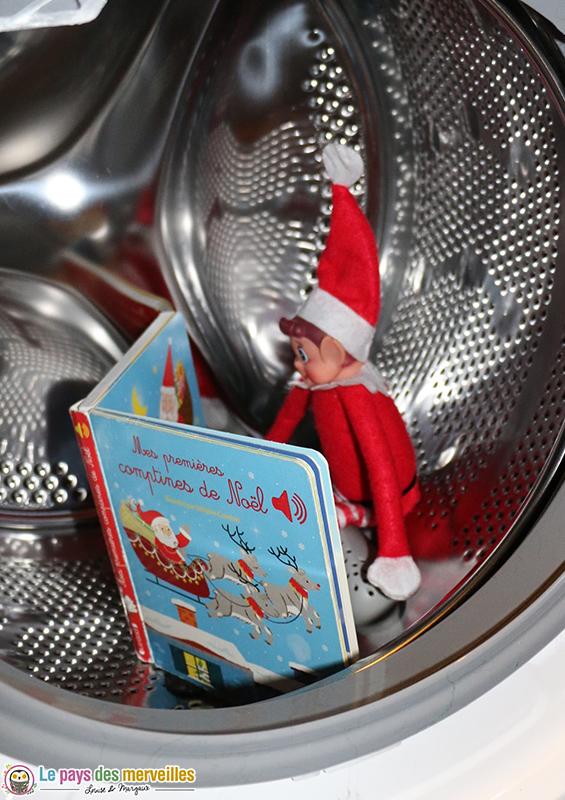 Lutin qui lit dans la machine à laver