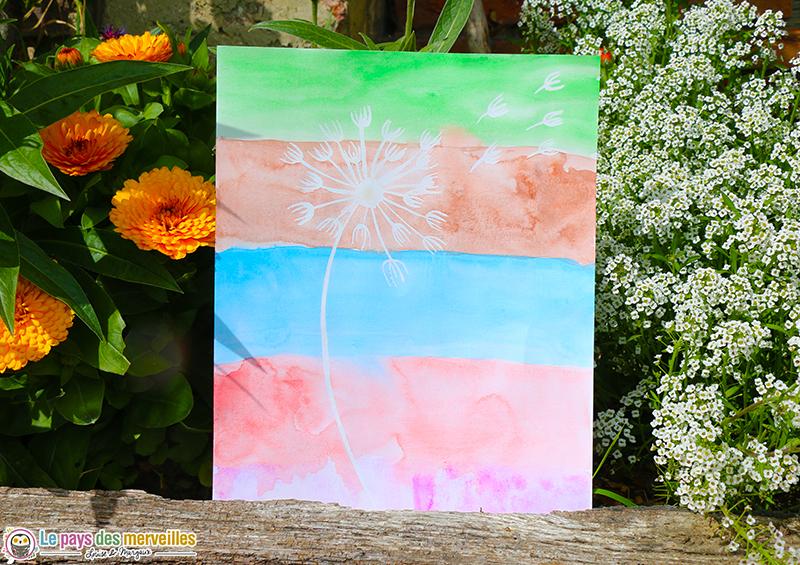 Pissenlit au drawing gum avec fond peint à l'aquarelle