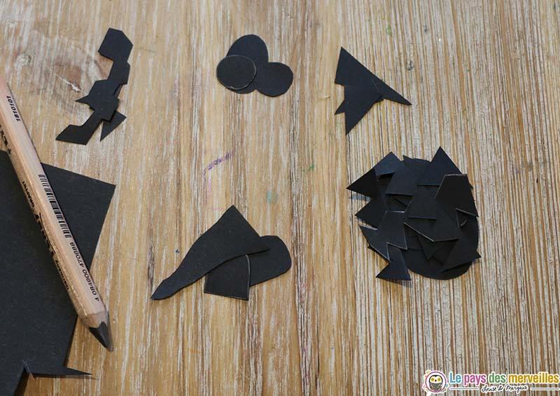 Visage de monstres et citrouilles dans du papier noir
